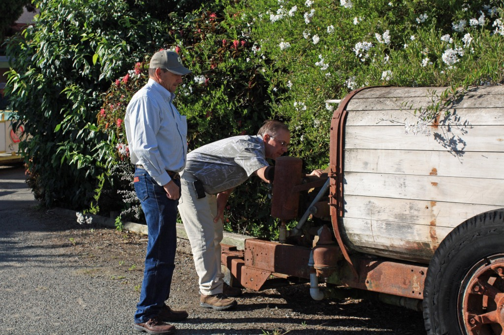 Bruce & Jon examining the old pump system on the antique wood tanked sprayer