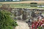 Beautiful rock walls surrounding the front yard