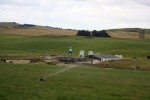 Dairy with a K-line irrigations sprinkler in the foreground